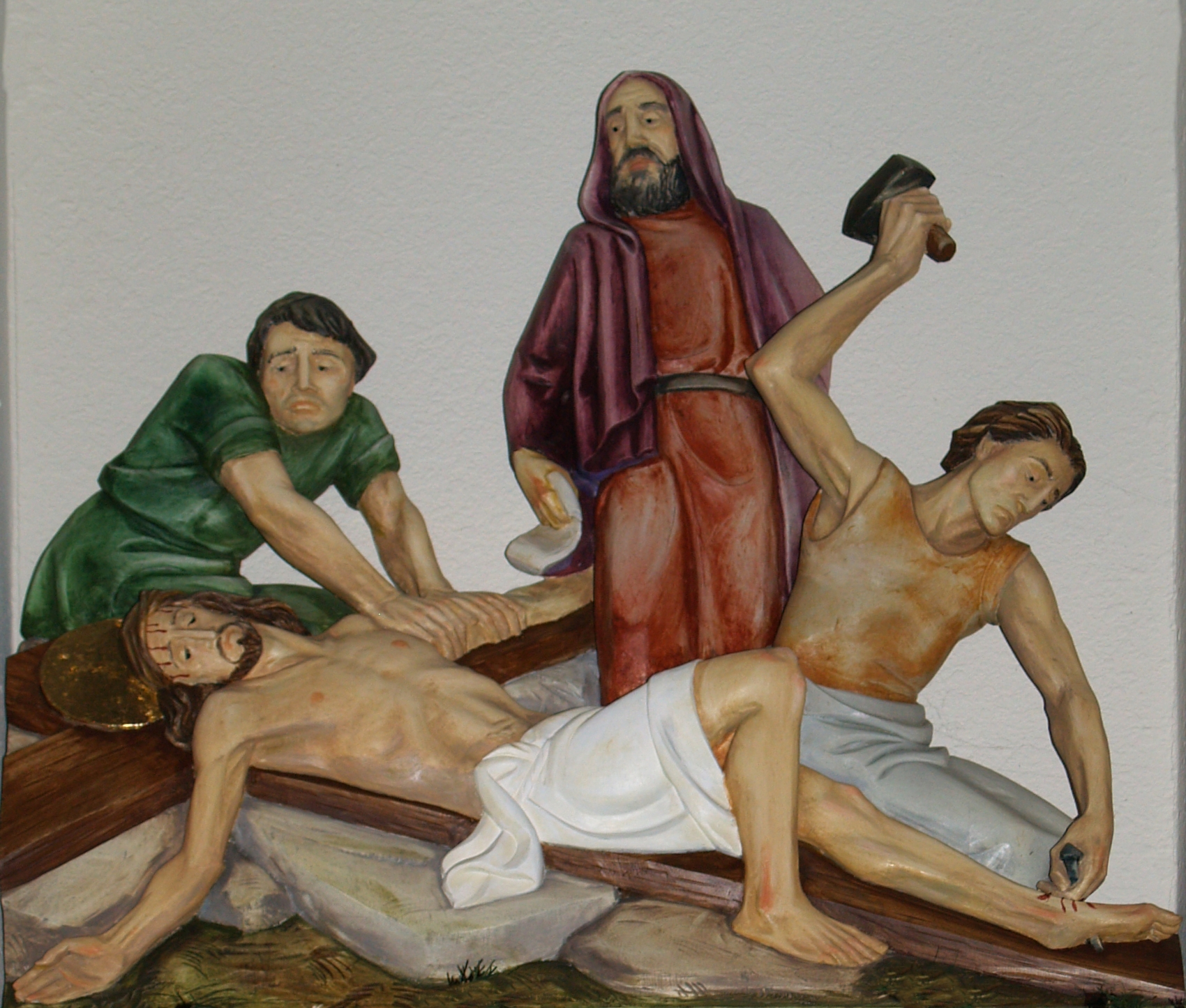 File:Jesus is nailed t...