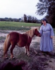 Religious Sister at the Franciscans' Saint Clare Monastery tends to one of the miniature horses.jpg